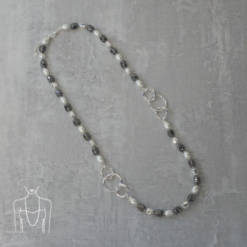 Long pearl necklace with silver hoops